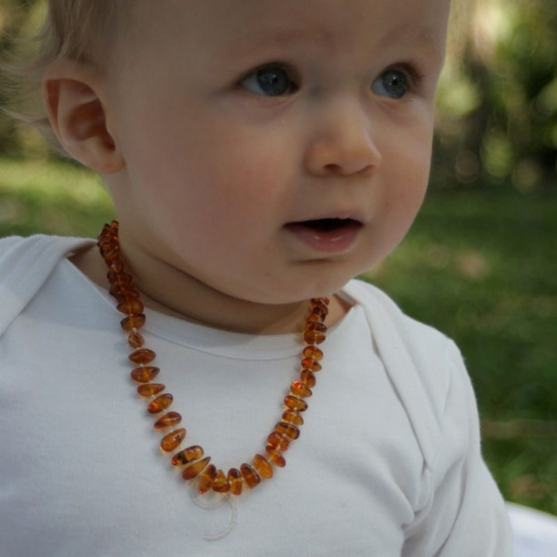 Child wearing Amber teething necklace